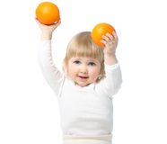 Baby showing oranges Royalty Free Stock Photography
