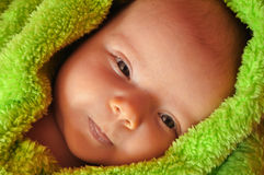 Baby showing tip of tongue royalty free stock photo