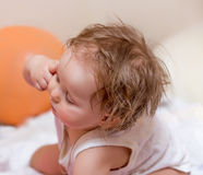Baby shows her head. Headache. Royalty Free Stock Photography