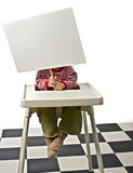 Baby sign chair. Baby on a chair holding a sign Stock Photo