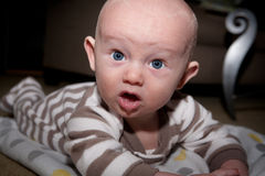 Baby With Silly Expression Drooling Royalty Free Stock Photo
