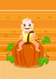 Baby sit on a big pumpkin Royalty Free Stock Photography