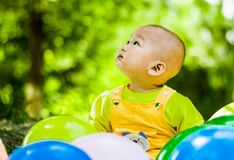 Baby plays with balloons