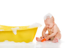 Baby Sits Beside Bath Royalty Free Stock Photography