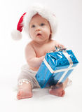 Baby sits with blue present box Royalty Free Stock Images