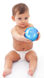 Baby sits at the floor with glob in her hand. Royalty Free Stock Photography
