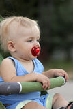 Baby sits in perambulator Royalty Free Stock Photo