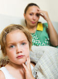 Baby-sitter and crying girl stock photo