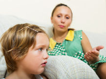 Baby-sitter and crying girl Stock Photos