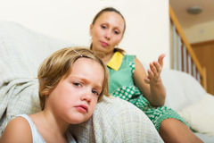 Baby-sitter and crying girl Royalty Free Stock Photos