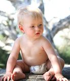 Baby sitting Stock Images