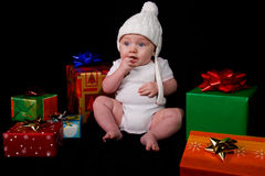 Baby Sitting Amongst Christmas Gifts Stock Image