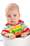 Baby sitting in the big saucepan. Stock Photography
