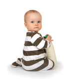 Baby sitting with a bottle of fresh milk kefir in hands Royalty Free Stock Images