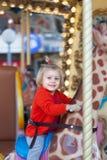 Baby sitting on  carousel giraffe Stock Photography