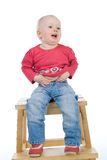 Baby sitting on a chair. Little girl sitting on a chair Royalty Free Stock Image