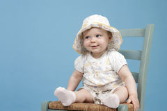 Baby sitting on a chair Stock Image