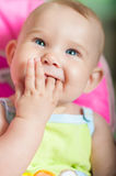 Baby sitting in a chair for feeding. At home Royalty Free Stock Photos