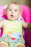Baby sitting in a chair for feeding. At home Stock Photos