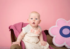 Baby Sitting on Couch Stock Photography