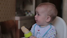 Baby sitting and eat at home stock video footage