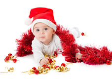 A baby is sitting on a floor Royalty Free Stock Photo