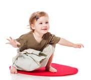 Toddler girl sitting Royalty Free Stock Photography