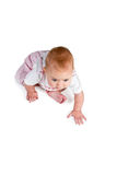 Baby sitting and going to crawl Stock Photography
