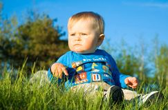 Baby sitting on grass Stock Images