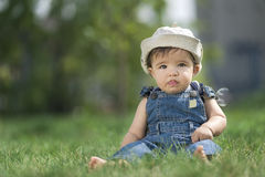 Baby sitting on the grass Royalty Free Stock Images
