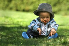 Baby sitting on the grass Royalty Free Stock Photography