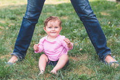 Baby sitting on a grass Stock Photography