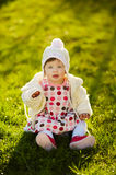 Baby sitting on grass in garden Royalty Free Stock Photos