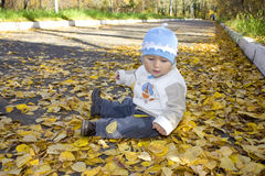 Baby sitting on the ground Royalty Free Stock Images
