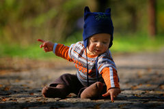 Baby sitting on the ground Stock Photography