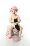 Baby sitting on hatboxes Royalty Free Stock Photos