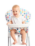 Baby sitting in a high chair isolated Stock Image