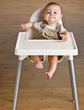 Baby sitting in highchair. Baby sitting in a highchair Royalty Free Stock Image