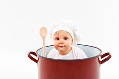Baby sitting inside a pot. Cute little baby  sitting in a huge pot Royalty Free Stock Image