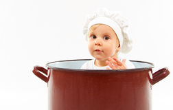 Baby sitting inside a pot Stock Photos