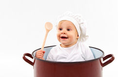Baby sitting inside a pot. Cute little baby  sitting in a huge pot Stock Photography