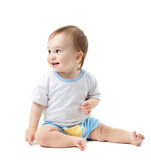 Baby sitting and looking sideways Royalty Free Stock Photography