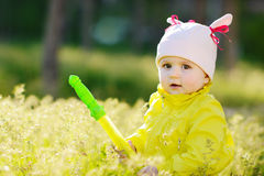 Baby sitting  on the meadow Stock Photography