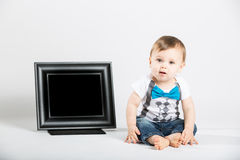 Baby Sitting Next to Picture Frame and Looking Interested Stock Photos