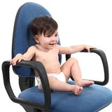 Baby sitting on an office chair Stock Photo