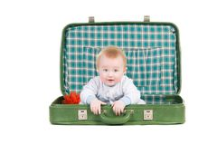 Baby sitting in an old green suitcase Royalty Free Stock Photography