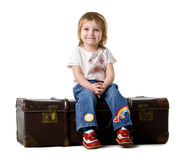 Baby sitting in a old suitcase royalty free stock photos