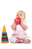 Baby sitting and playing with a ball Stock Images