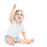 Baby sitting and points his hand up Royalty Free Stock Image