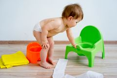 Baby sitting on a potty royalty free stock photos
